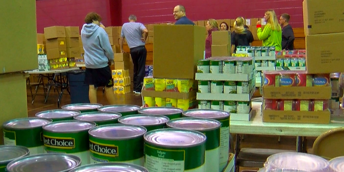 Volunteers pack baskets for St. John's Christmas Food Drive