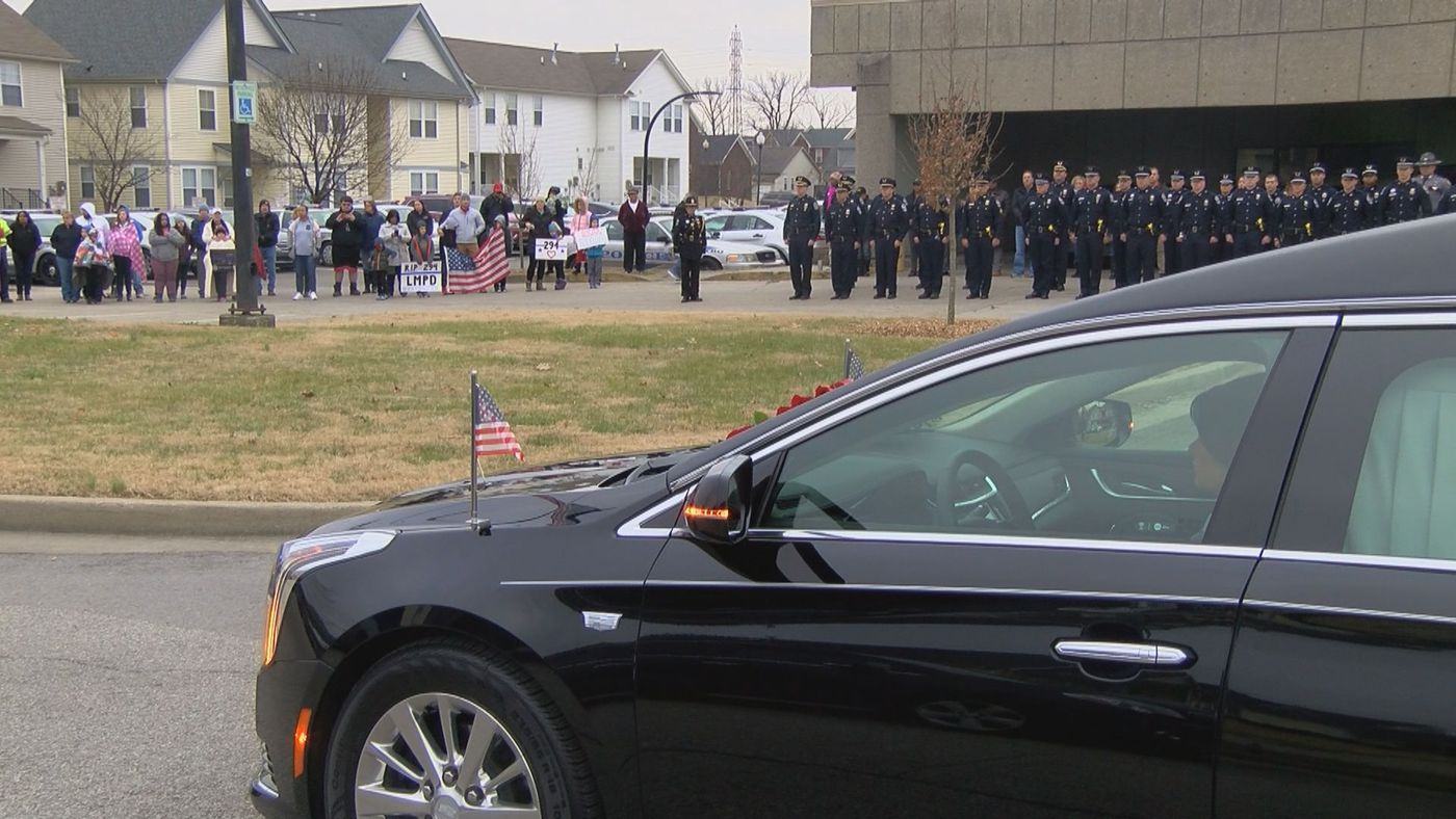 LMPD officers line up to honor Detective Mengadoht as the hearse carrying her drives by.