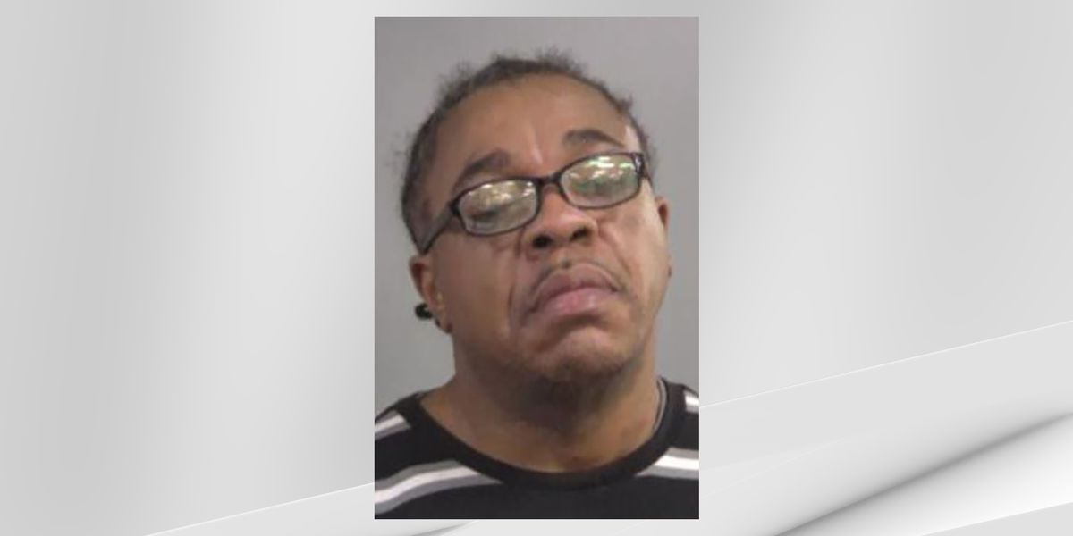 Man accused of trying to stab officer with scissors