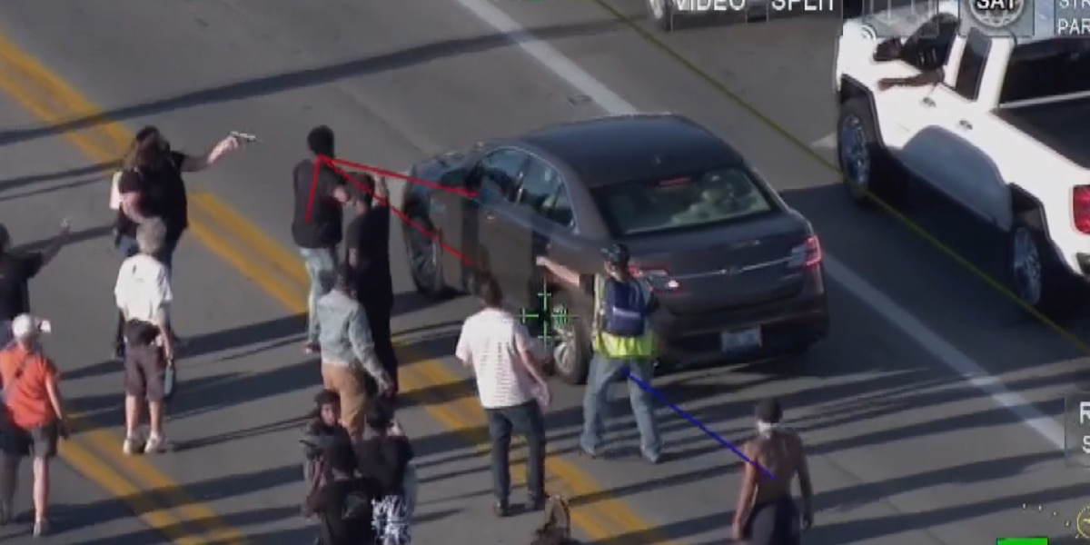 Police release video of woman pointing gun at driver during Shelbyville Road protest