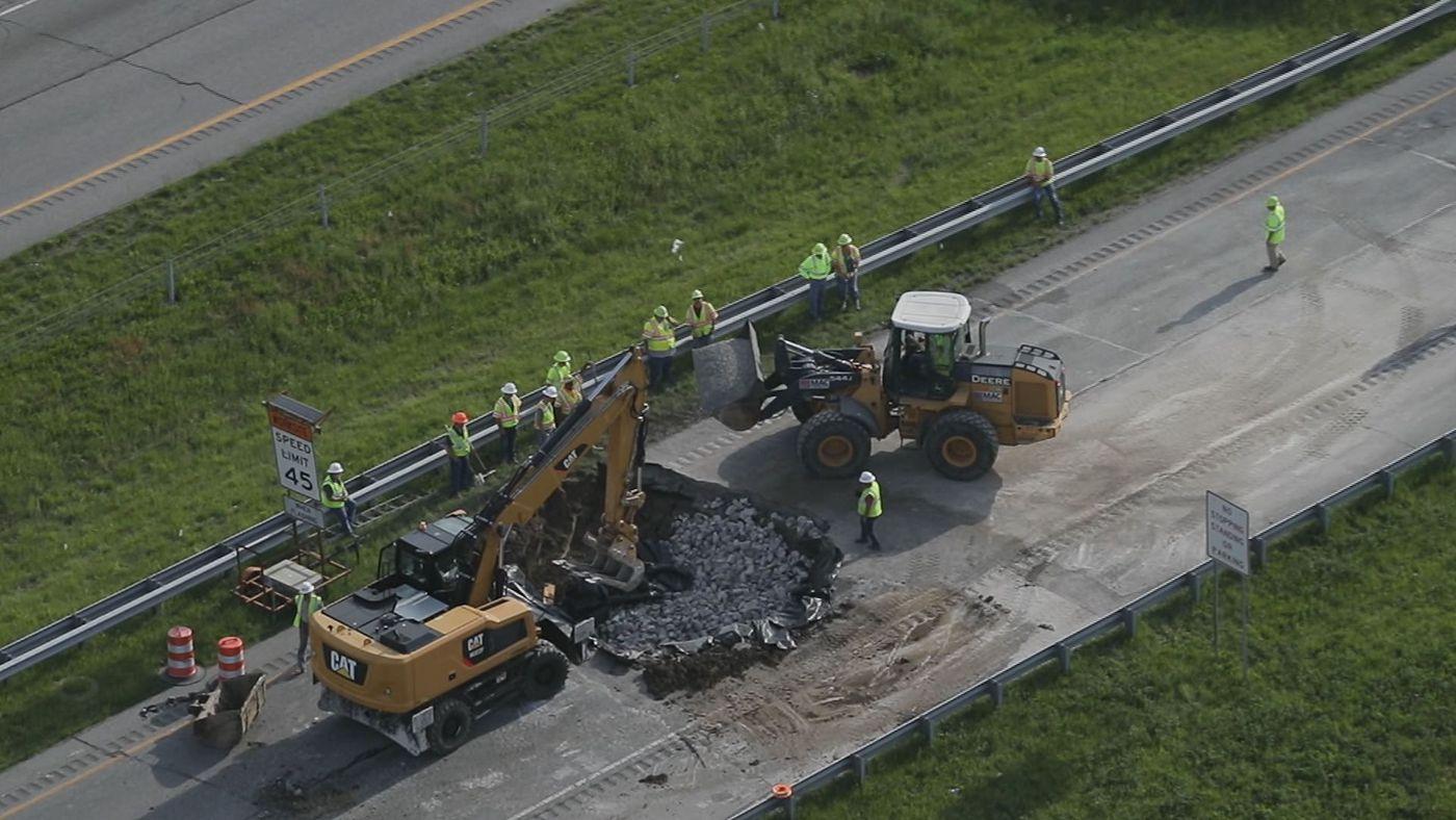 2 dead, 3 injured in chain-reaction crash near sinkhole on I-265