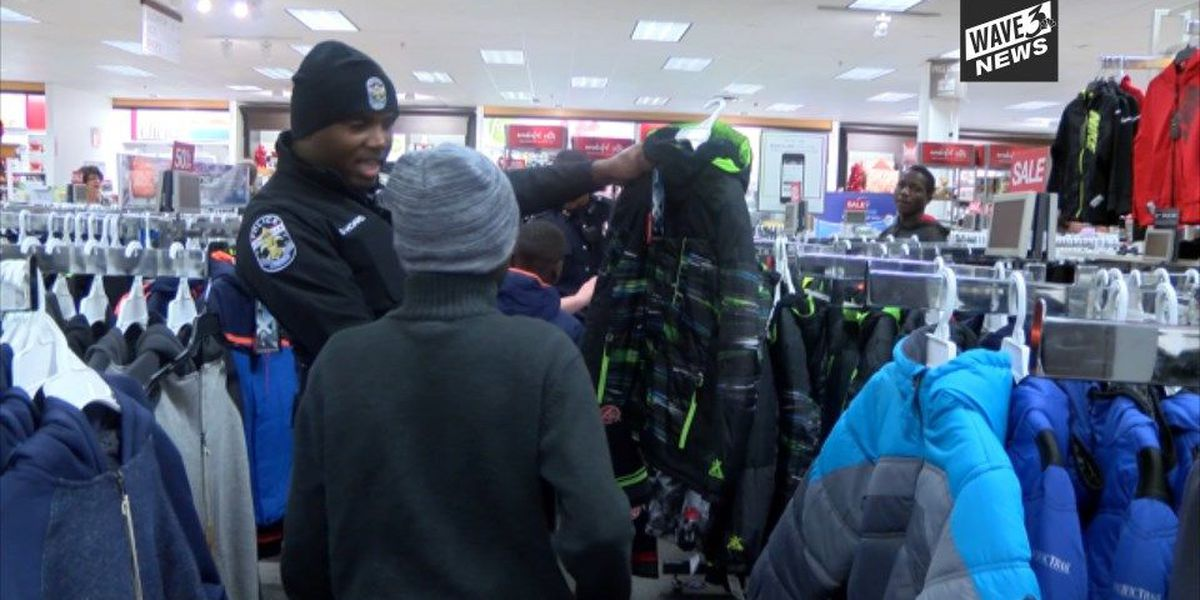 LMPD officers surprise refugee families with free clothes for a year