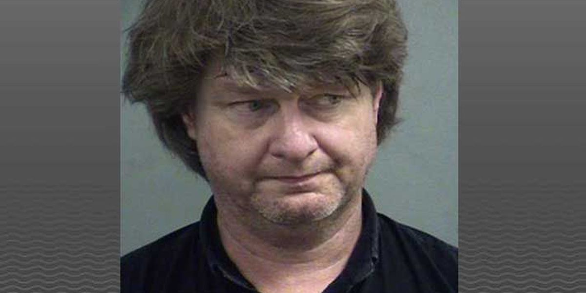 Louisville man arrested after allegedly pointing loaded shotgun at neighbor