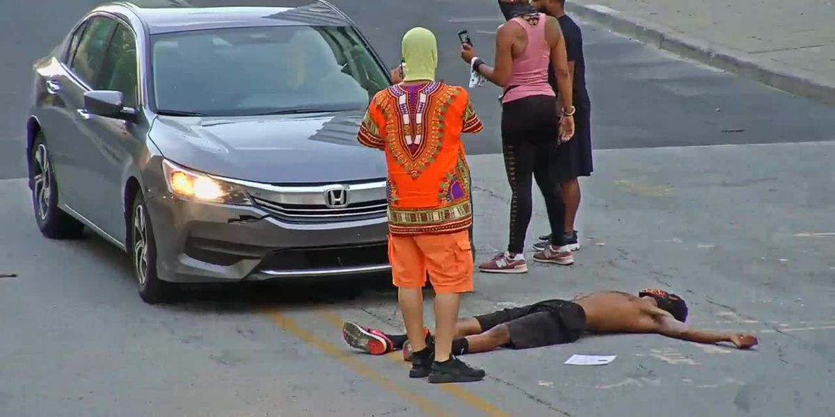 LMPD video shows demonstrator kicking car after pretending to be hit on Armory Place