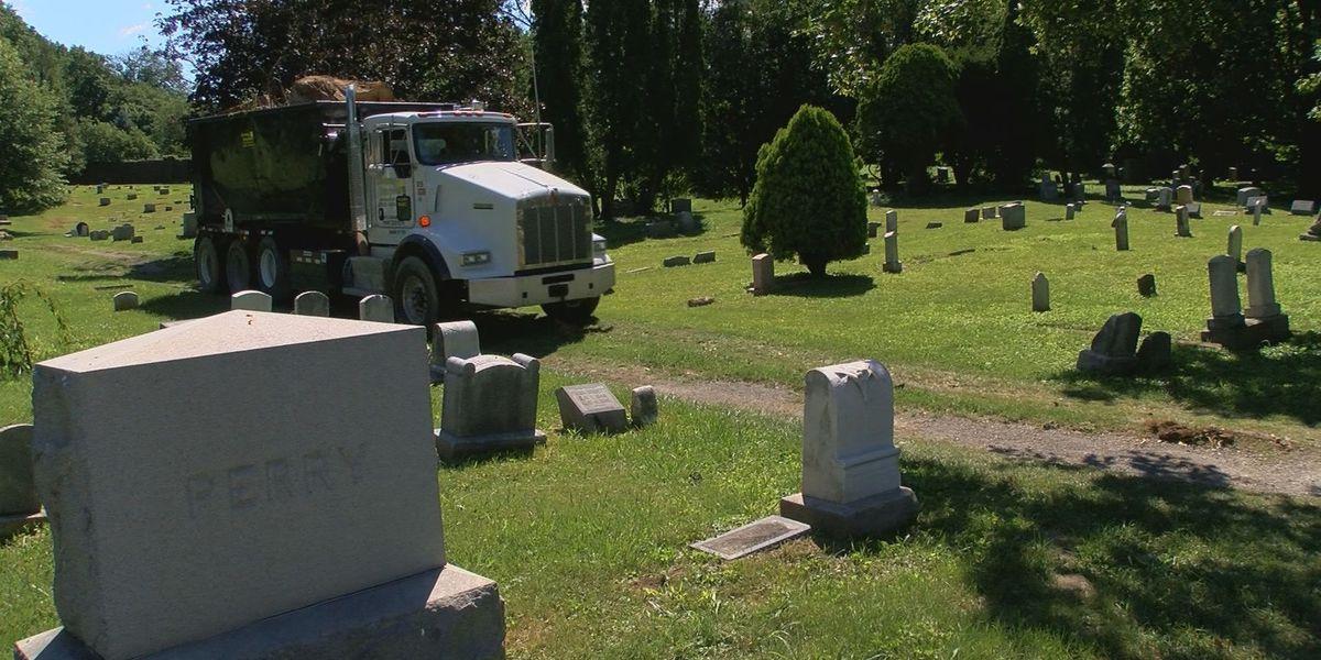 Army of volunteers helps clean up abandoned cemetery