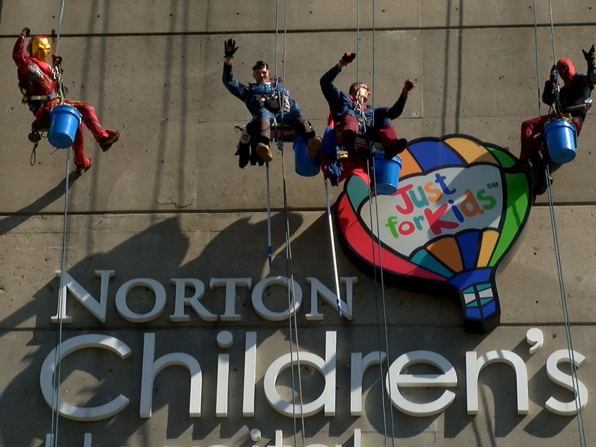 League of superheroes gather to wash windows at Norton Children's Hospital