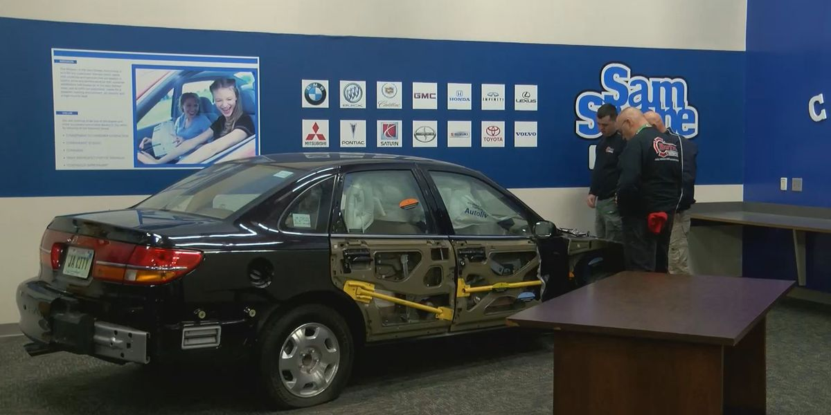 Fairdale High students dismantle a trapped car