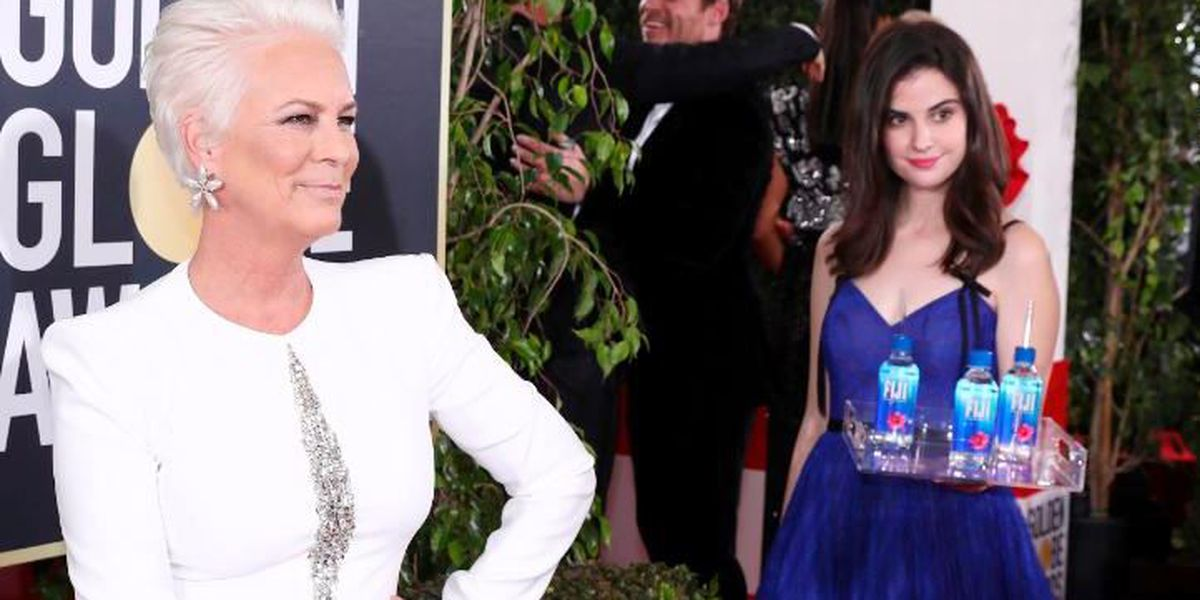 Who's that girl? The Fiji Water girl photobombs her way into Golden Globe history