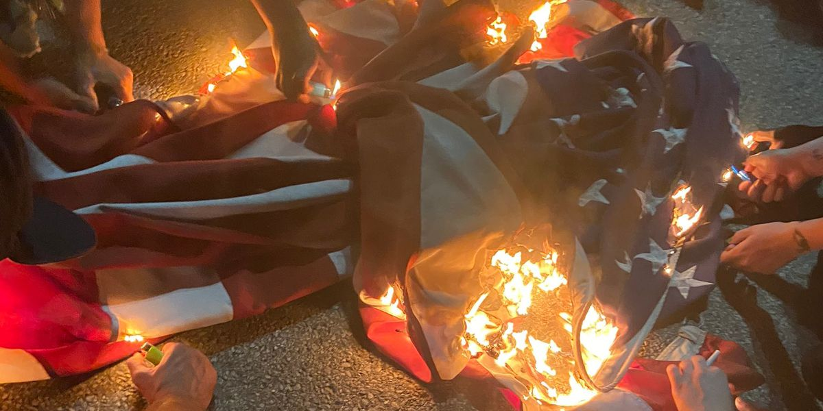 Protesters burn American flag, spray paint outside convention center after budget hearing goes awry