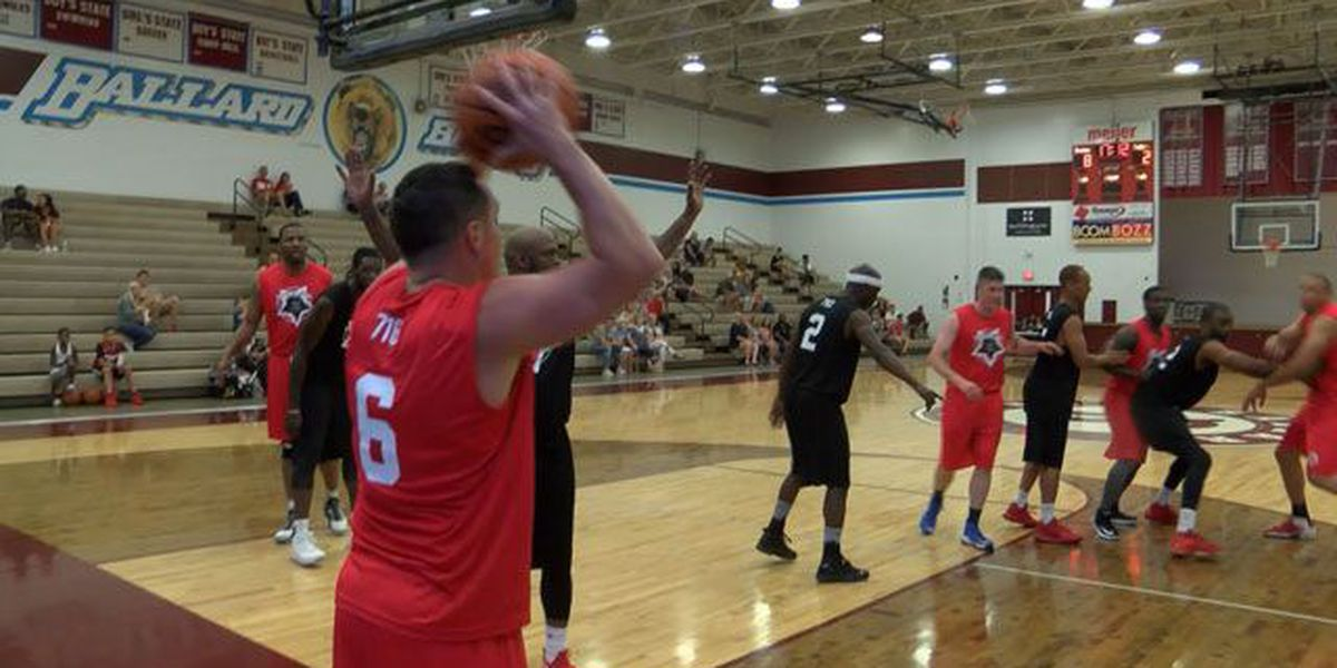 UofL legends, LMPD officers play hoops to benefit fallen officer's family