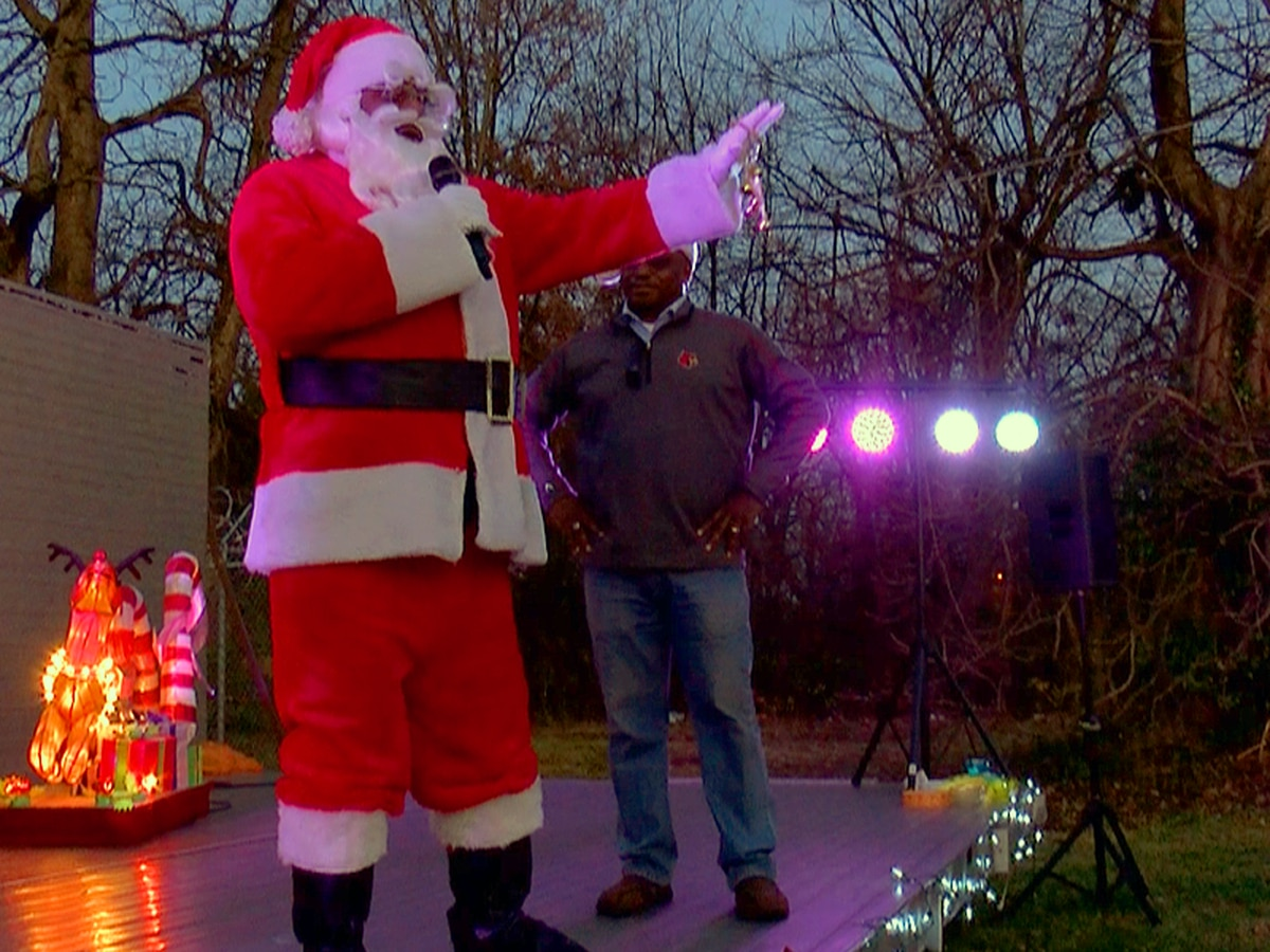 Santa visits Louisville's California neighborhood to spread Christmas cheer