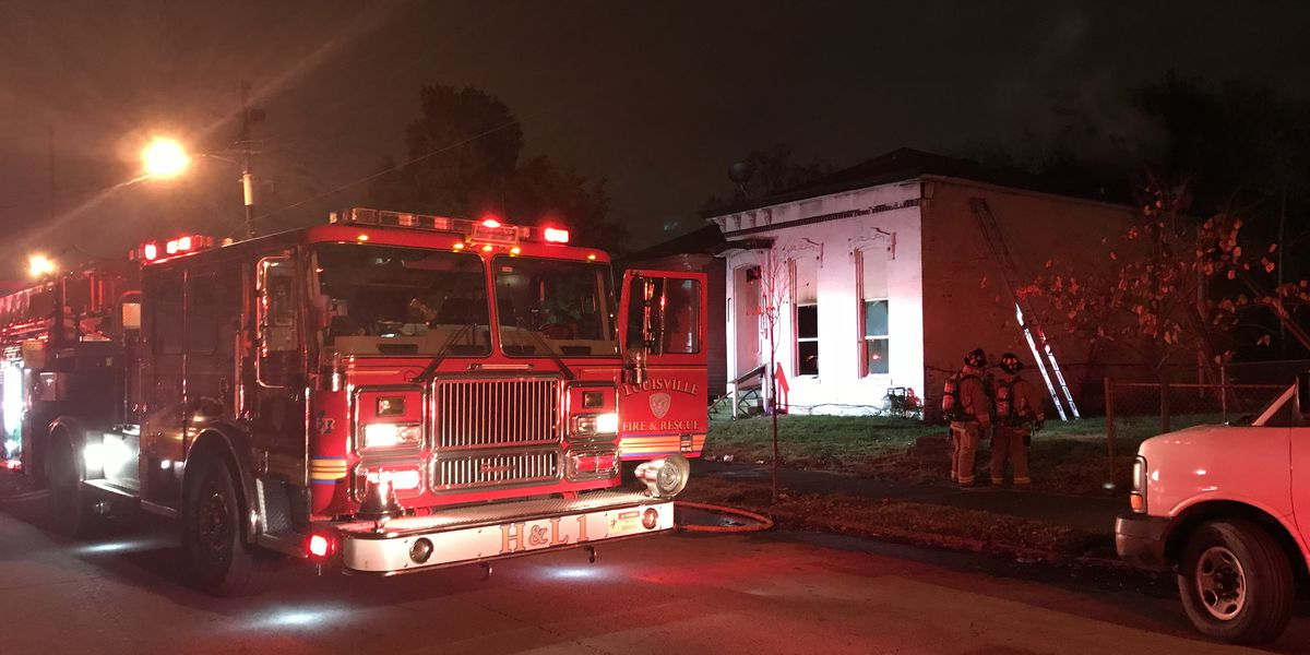Crews rescue 2 from house fire in Russell neighborhood