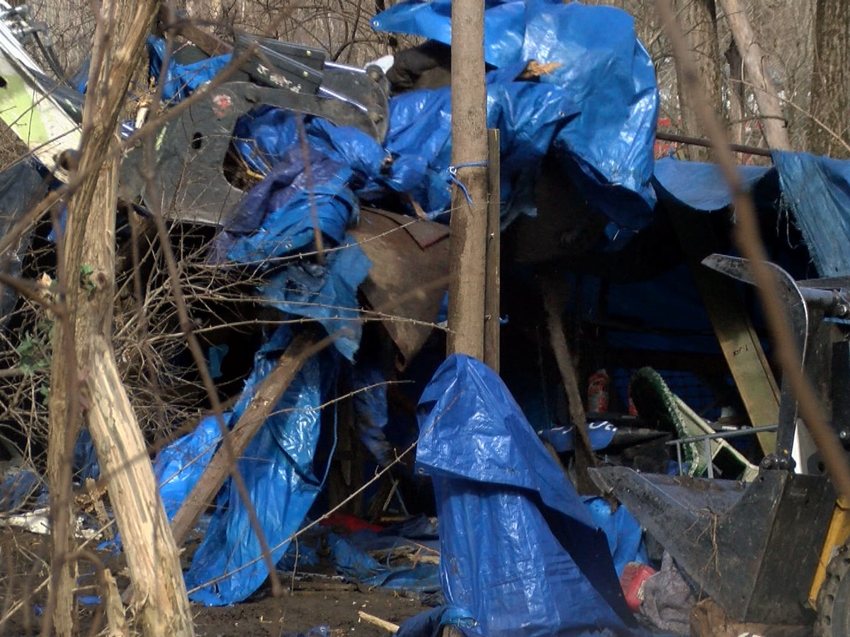 Homeless camp off Lexington Road cleared away by waste management crews